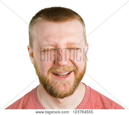 Young funny bearded man with narrowed eyes