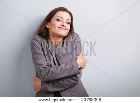 Happy Business Woman Hugging Herself With Closed Eyes And Natural Emotional Face. Love Concept Of Yo