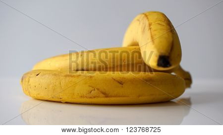 Old yellow bananas isolated on white background