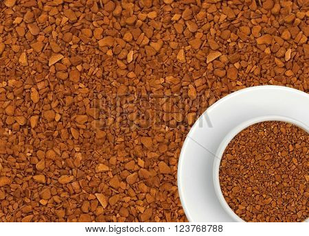 Granules of instant coffee and white coffee cup