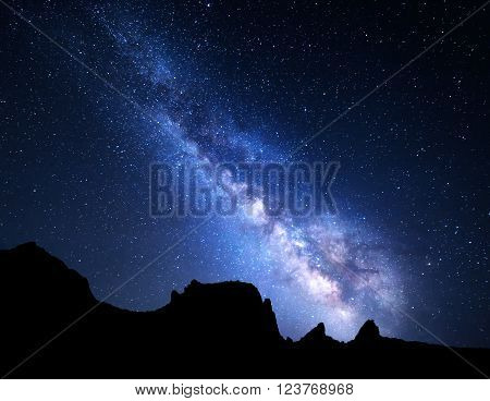 Mountain landscape with Milky Way. Night sky with stars at summer.