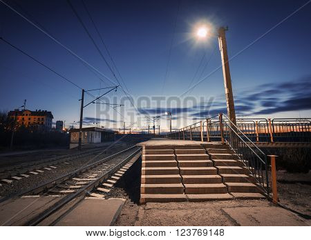 Rural Railway Station At Night With Blue Sky. Railroad