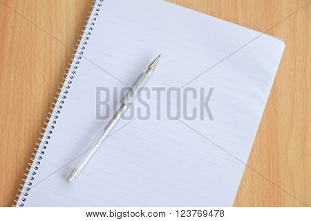 Opened notepad and pen on the table