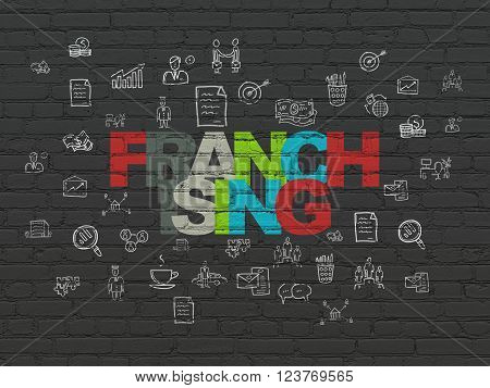 Business concept: Franchising on wall background