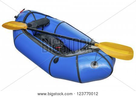 a blue packraft (one-person light raft used for expedition or adventure racing) with a paddle isolated on white with a clipping path
