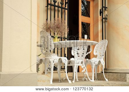 Old style chairs and table on the terrace of the castle
