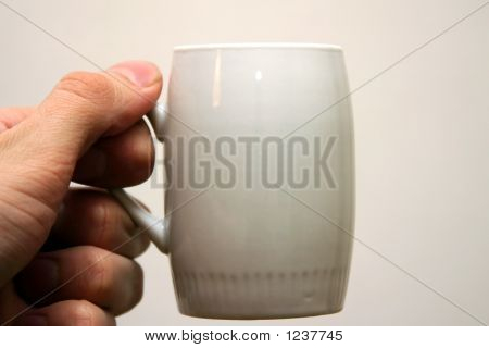 Hand With Cofee Cup.