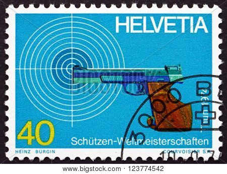 SWITZERLAND - CIRCA 1974: a stamp printed in the Switzerland shows Target and Pistol World Marksmanship Championships Thun and Bern circa 1974