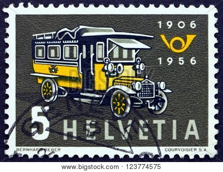 SWITZERLAND - CIRCA 1956: a stamp printed in the Switzerland shows First Swiss Post Bus 50th Anniversary of the Swiss Motor Coach Service circa 1956