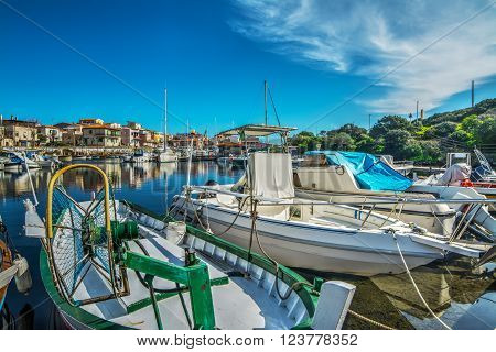 wooden boats in Stintino port in Sardinia
