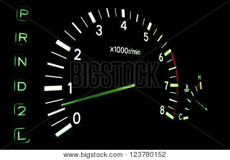 The tachometer on the instrument panel in the car