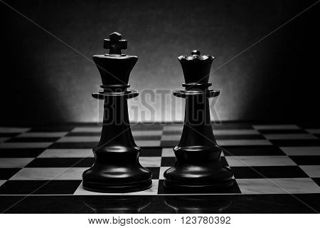 Chess. Black King and Queen on the board .The most powerful figures. Set of chess figures.