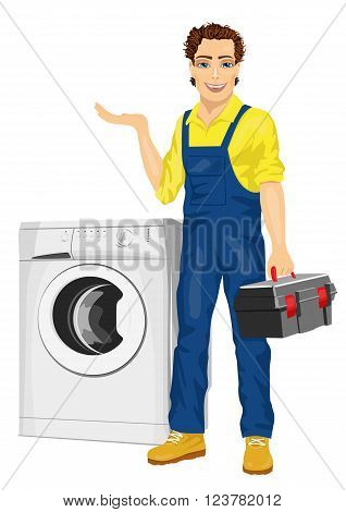 Repairman holding a toolbox and posing next to a washing machine showing something isolated on white background