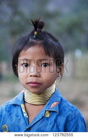CHIANG MAI, THAILAND - FEBRUARY 01, 2016: Unidentified girl from Karen Long Neck Village near Chiang Mai Thailand. This village is a part of very popular Hill tribe tourism in Thailand.