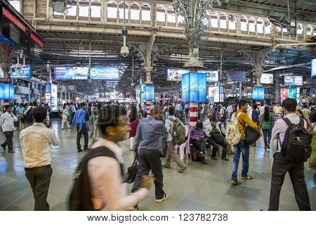 MUMBAI, INDIA - OCTOBER 9, 2015: Unidentified people at platform of Chhatrapati Shivaji erminus railway station in Mumbai India. Chhatrapati Shivaji Terminus is a UNESCO World Heritage Site and an historic railway station in Mumbai Maharashtra India