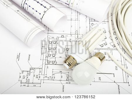 Architecture plan and rolls of blueprints with bulbs. Building concept