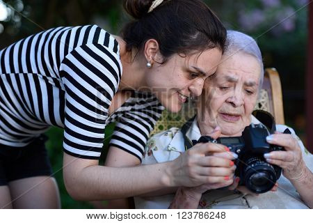 Grandma Holding Photo Camera