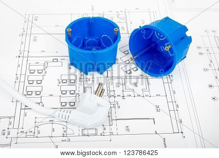 Architecture plan and rolls of blueprints with plug and plastic covers. Building concept