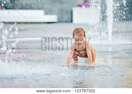 baby in the fountain. The boy in the fountain.