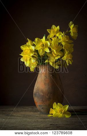 Still life with a bouquet of yellow narcissuses