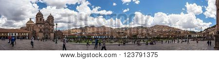 Cusco, Peru - September 3, 2015: People on main square, Plaza de Armas, with facade of church in Cusco, Peru, former Inca capital, famous travel destination in the world. HD composite panorama.