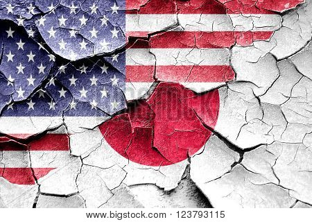Grunge Japan flag combined with american flag