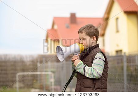 Boy Shouts Something Into The Megaphone
