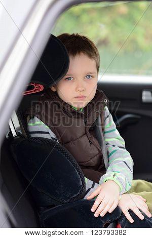Sad Little Boy Preschooler In Car Safety Seat