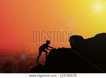 Women silhouette climbing on cliff with blurred twilight city top view and sunlight effect with copy space