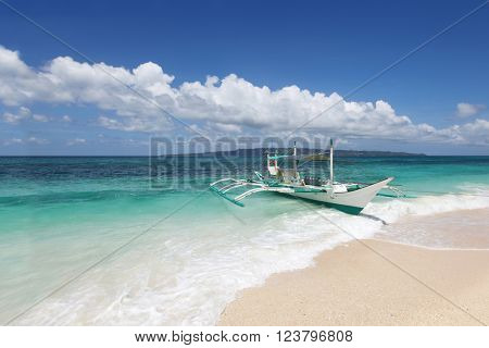 Boat on beach and tropical sea of Philippines at sunny day