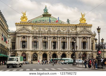 PARIS, FRANCE - JUNE 16, 2014. with Traffic and tourists in front of Palais Garnier Opera House