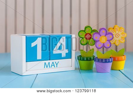 May 14th. Image of may 14 wooden color calendar on white background with flowers. Spring day, empty space for text. Astronomy Day. World Fair Trade DAY.