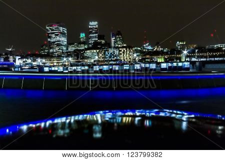 London, United Kingdom - March 23, 2016: Water Stories is an art exhibition event taking place near the Tower Bridge and in front of a London Skyline with Fenchurch, Leadenhall and Gherkin buildings in London, United Kingdom, on the 23rd of March 2016.