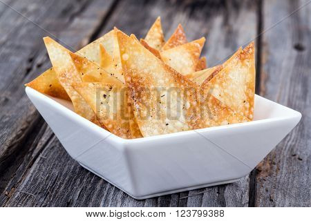 fried wonton sheet chips bowl appetizer on table