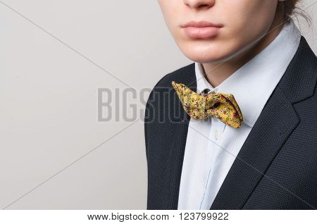 Man in suit jacket shirt funny yellow butterfly. Space for text. Selected focus