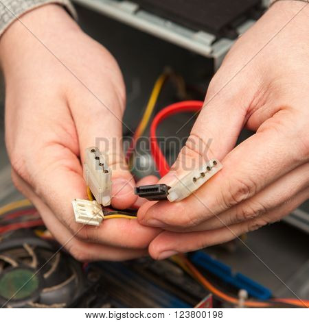 The Master Keeps In The Hands Of The Cables. Disassembled System Unit.