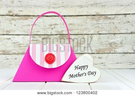 Handmade Mothers Day Purse Gift Bag With Heart Tag Against A Rustic White Wood Background