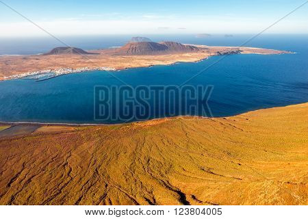 Wide angle view on Graciosa island from El Rio viewpoint on Lanzarote island in Spain