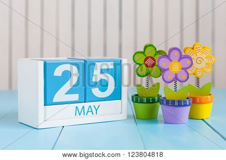 May 25th. Image of may 25 wooden color calendar on white background with flowers. Spring day, empty space for text. International Missing Children Day. World Thyroid DAY.