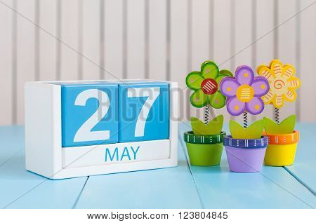 May 27th. Image of may 27 wooden color calendar on white background with flowers. Spring day, empty space for text. European Neighbours Day.