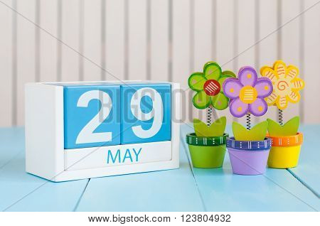 May 29th. Image of may 29 wooden color calendar on white background with flowers. Spring day, empty space for text. International Day Of United Nations Peacekeepers.