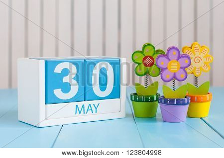 May 30th. Image of may 30 wooden color calendar on white background with flower. Spring day, empty space for text.  International or World Press Freedom Day.