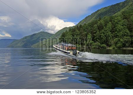 ALTAI RUSSIA - JUNE 13 2013: Powerboat on Teletskoye Lake Altai mountains
