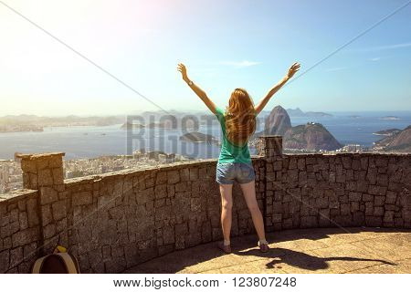 girl tourist with a backpack on the background Rio de Janeiro. view on Pao de Acucar ** Note: Soft Focus at 100%, best at smaller sizes