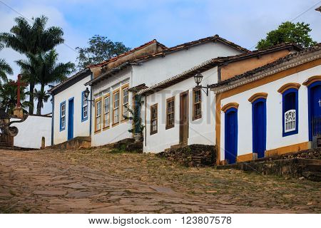 Girl tourist walks in the streets of the famous historical town Tiradentes, Minas Gerais, Brazil