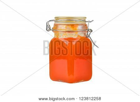 Apricot jam in glass jar isolated on white background