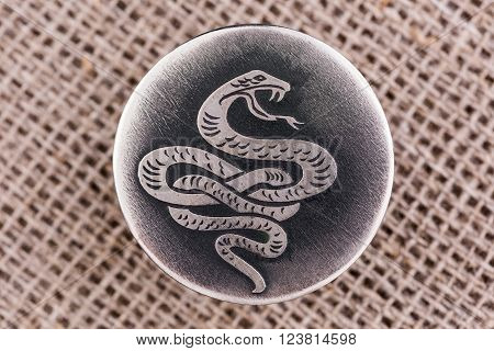 The snake - a symbol of wisdom and vitality, the guardian of life and health.