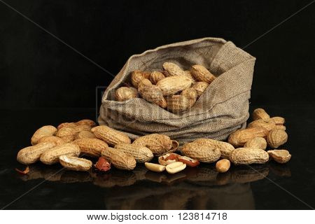 Peanut in a bag on a black background