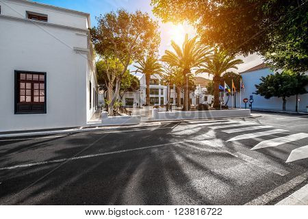 Street view with traditional whitewashed buildings in Yaiza village on Lanzarote island in Spain