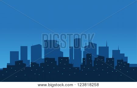 silhoutte of city at night with blue bakcground